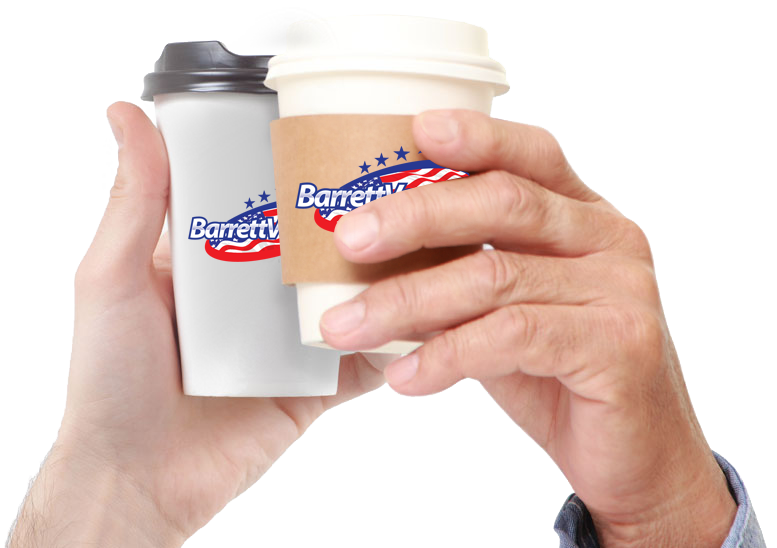 Hands holding paper coffee cups in an office