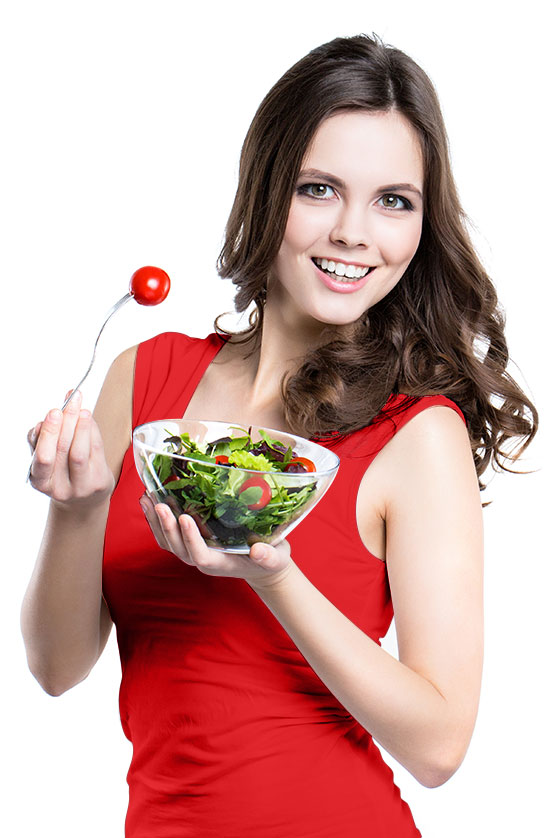 Happy woman eating delicious salad in Houston